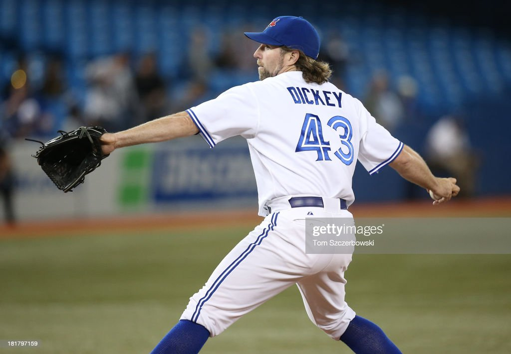 R.A. Dickey #43 of the Toronto Blue Jays delivers a pitch during MLB game action against the New York Yankees on September 17, 2013 at Rogers Centre in Toronto, Ontario, Canada.