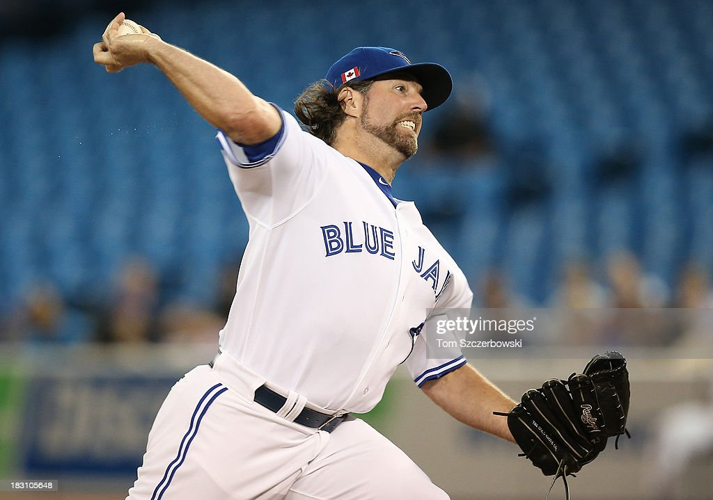 R.A. Dickey #43 of the Toronto Blue Jays delivers a pitch during MLB game action against the Los Angeles Angels of Anaheim on September 11, 2013 at Rogers Centre in Toronto, Ontario, Canada.