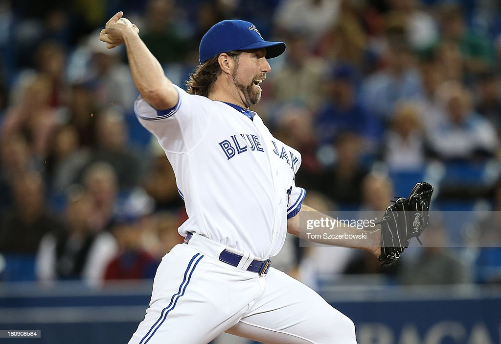 R.A. Dickey #43 of the Toronto Blue Jays delivers a pitch in the first inning during MLB game action against the New York Yankees on September 17, 2013 at Rogers Centre in Toronto, Ontario, Canada.