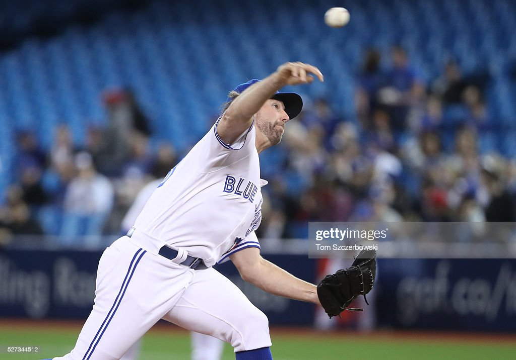R.A. Dickey #43 of the Toronto Blue Jays delivers a pitch in the first inning during MLB game action against the Texas Rangers on May 2, 2016 at Rogers Centre in Toronto, Ontario, Canada.