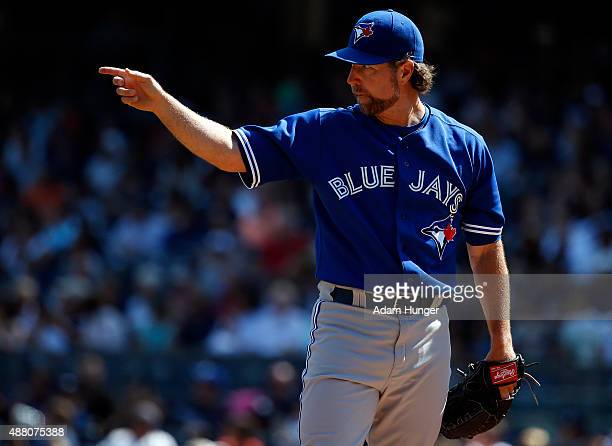 A Dickey of the Toronto Blue Jays gestures in the second inning against the Toronto Blue Jays at Yankee Stadium on September 13 2015 in the Bronx...