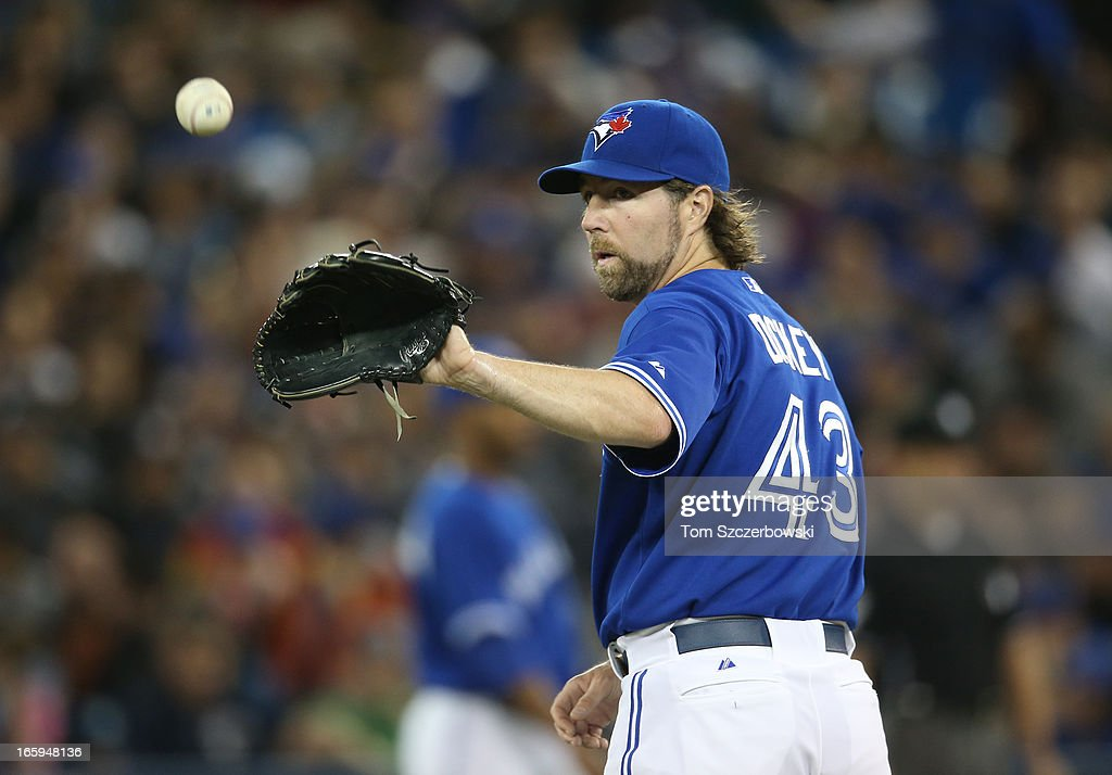 R.A. Dickey #43 of the Toronto Blue Jays gets the ball back after surrendering a hit during MLB game action against the Boston Red Sox on April 7, 2013 at Rogers Centre in Toronto, Ontario, Canada.