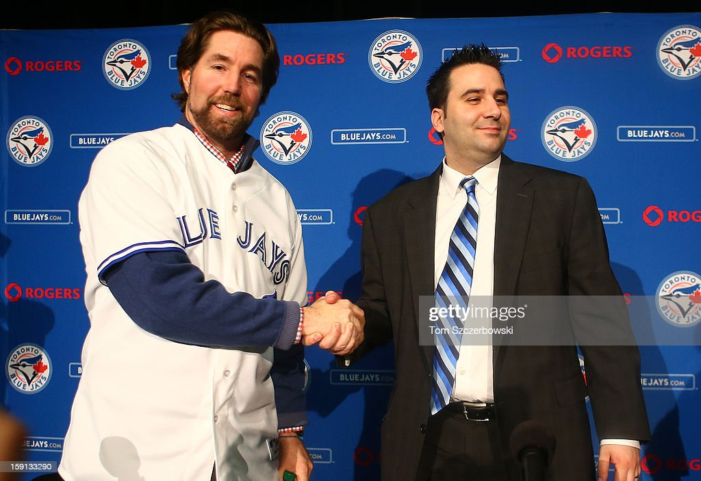 R.A. Dickey #43 (L) of the Toronto Blue Jays is introduced at a press conference as he shakes hands with general manager Alex Anthopoulos at Rogers Centre on January 8, 2013 in Toronto, Ontario, Canada.