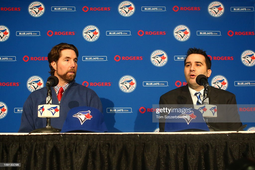 R.A. Dickey #43 (L) of the Toronto Blue Jays is introduced at a press conference by general manager Alex Anthopoulos at Rogers Centre on January 8, 2013 in Toronto, Ontario, Canada.