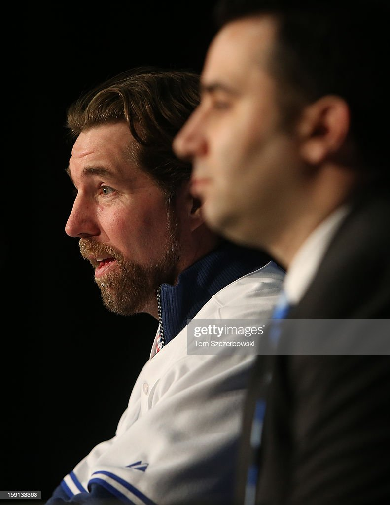 R.A. Dickey #43 of the Toronto Blue Jays is introduced at a press conference as general manager Alex Anthopoulos looks on at Rogers Centre on January 8, 2013 in Toronto, Ontario, Canada.