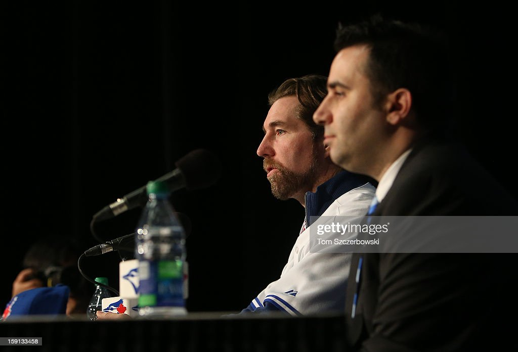 R.A. Dickey #43 (L) of the Toronto Blue Jays is introduced at a press conference as general manager Alex Anthopoulos looks on at Rogers Centre on January 8, 2013 in Toronto, Ontario, Canada.