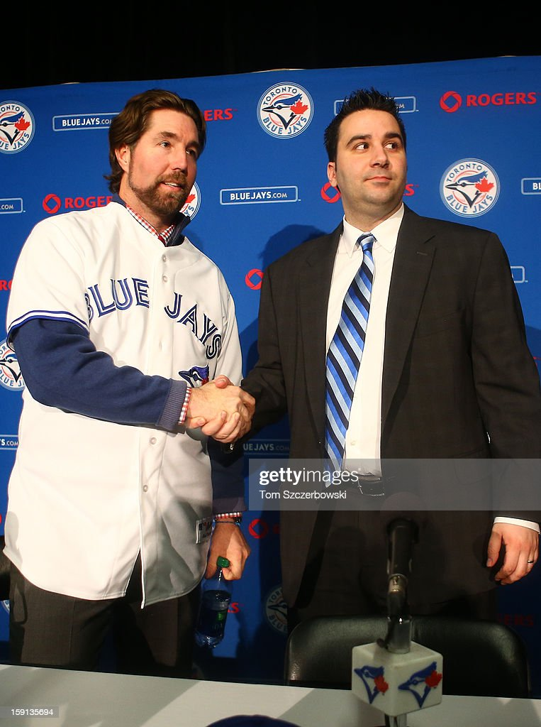 R.A. Dickey #43 of the Toronto Blue Jays is introduced at a press conference as he shakes hands with general manager Alex Anthopoulos at Rogers Centre on January 8, 2013 in Toronto, Ontario, Canada.