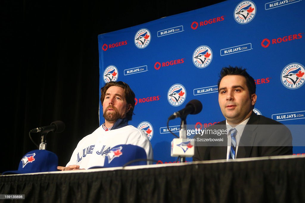 R.A. Dickey #43 of the Toronto Blue Jays is introduced at a press conference by general manager <a gi-track='captionPersonalityLinkClicked' href=/galleries/search?phrase=Alex+Anthopoulos&family=editorial&specificpeople=6770623 ng-click='$event.stopPropagation()'>Alex Anthopoulos</a> at Rogers Centre on January 8, 2013 in Toronto, Ontario, Canada.