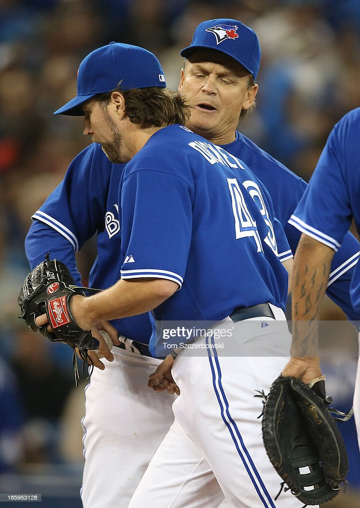 R.A. Dickey #43 of the Toronto Blue Jays is relieved in the fifth inning as manager <a gi-track='captionPersonalityLinkClicked' href=/galleries/search?phrase=John+Gibbons&family=editorial&specificpeople=218120 ng-click='$event.stopPropagation()'>John Gibbons</a> #5 makes a pitching change during MLB game action against the Boston Red Sox on April 7, 2013 at Rogers Centre in Toronto, Ontario, Canada.