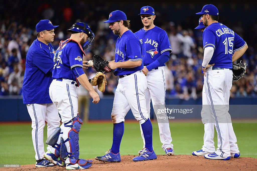 <a gi-track='captionPersonalityLinkClicked' href=/galleries/search?phrase=R.A.+Dickey&family=editorial&specificpeople=221719 ng-click='$event.stopPropagation()'>R.A. Dickey</a> #43 of the Toronto Blue Jays is relieved in the second inning against the Kansas City Royals during game four of the American League Championship Series at Rogers Centre on October 20, 2015 in Toronto, Canada.