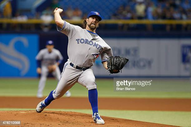 A Dickey of the Toronto Blue Jays pitches during the first inning of a game against the Tampa Bay Rays on June 23 2015 at Tropicana Field in St...