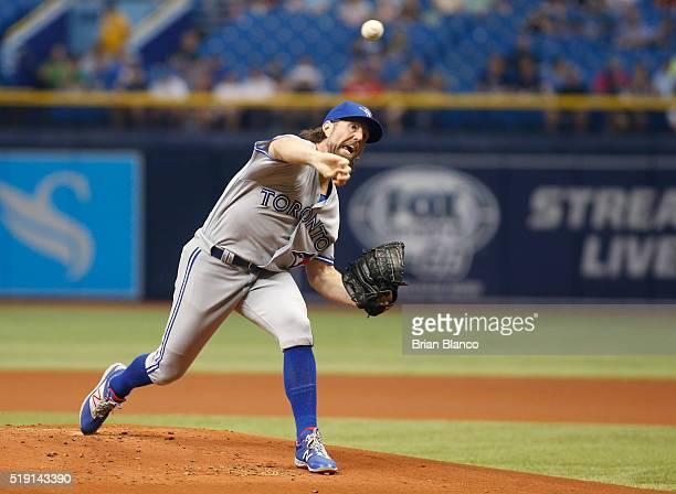 A Dickey of the Toronto Blue Jays pitches during the first inning of a game against the Tampa Bay Rays on April 4 2016 at Tropicana Field in St...