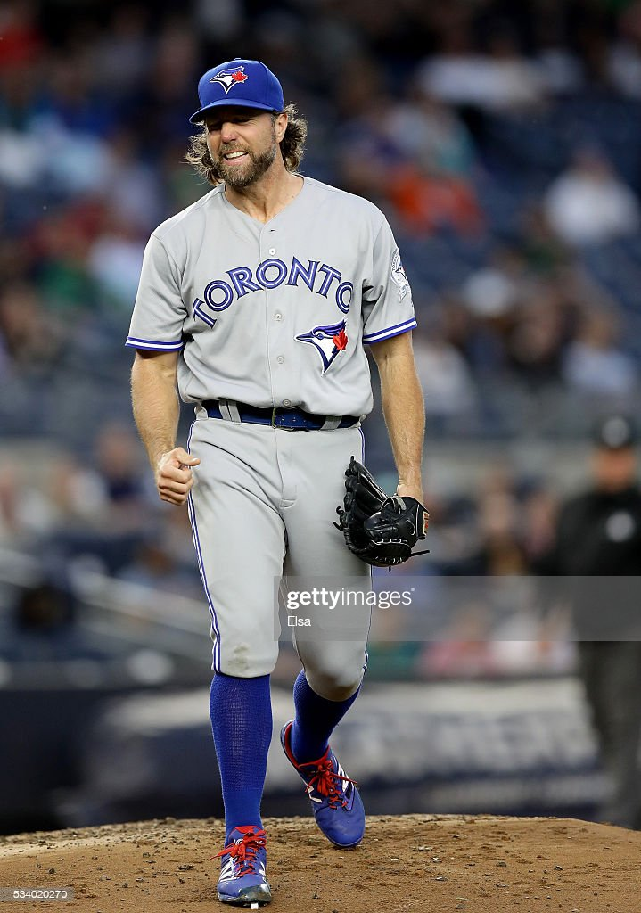 R.A. Dickey #43 of the Toronto Blue Jays reacts after he is unable to pick off Brett Gardner #11 of the New York Yankees at first base in the first inning at Yankee Stadium on May 24, 2016 in the Bronx borough of New York City.