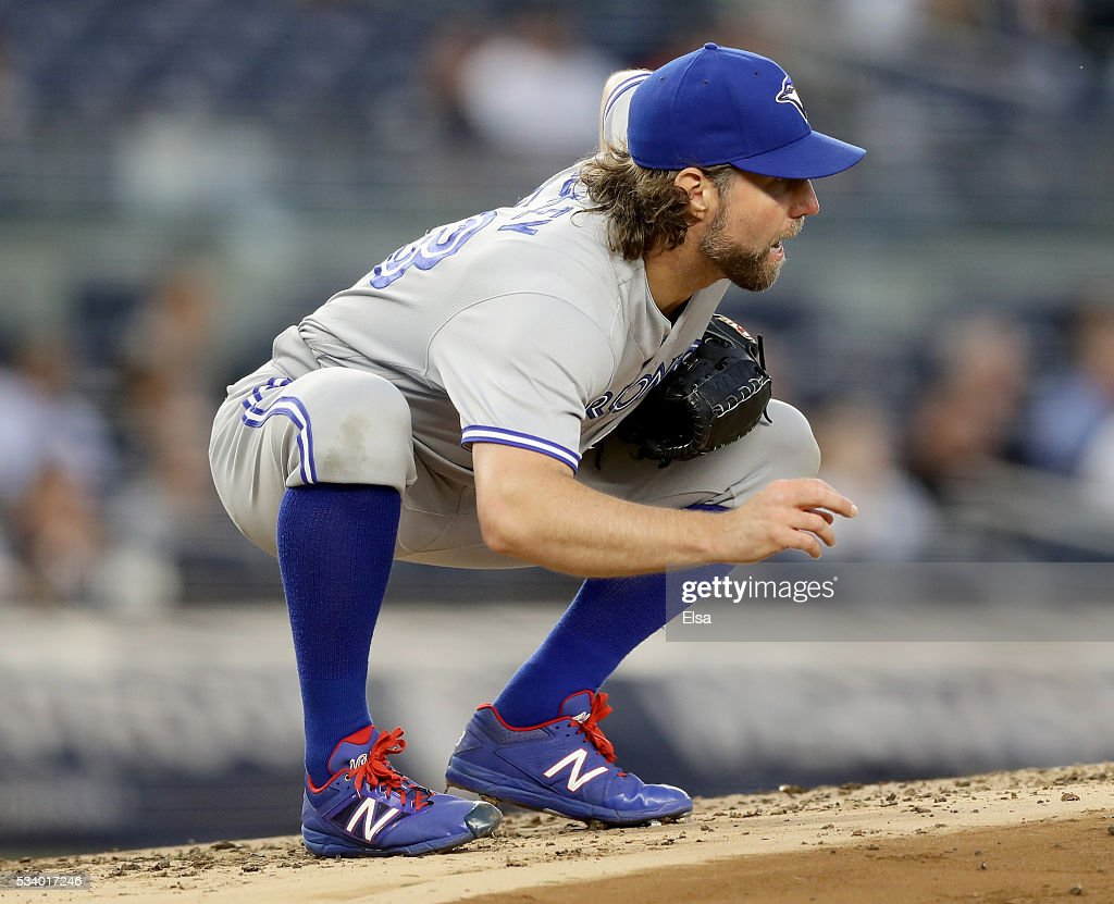 <a gi-track='captionPersonalityLinkClicked' href=/galleries/search?phrase=R.A.+Dickey&family=editorial&specificpeople=221719 ng-click='$event.stopPropagation()'>R.A. Dickey</a> #43 of the Toronto Blue Jays reacts after Jacoby Ellsbury of the New York Yankees hits a triple in the first innin gat Yankee Stadium on May 24, 2016 in the Bronx borough of New York City.