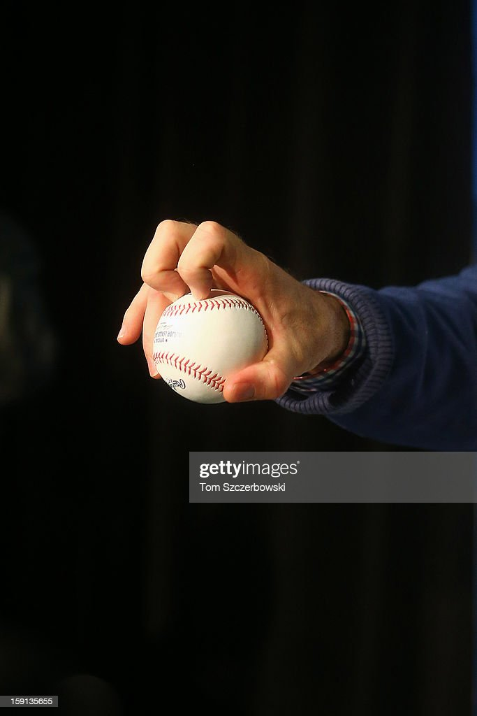 R.A. Dickey #43 of the Toronto Blue Jays shows his knuckleball grip after concluding the press conference that introduced him to Toronto media at Rogers Centre on January 8, 2013 in Toronto, Ontario, Canada.