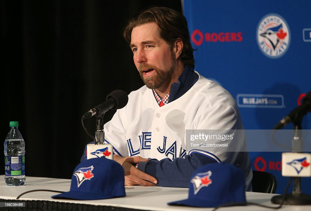 R.A. Dickey #43 of the Toronto Blue Jays tells reporters about his sexual abuse during his introduction at a press conference at Rogers Centre on January 8, 2013 in Toronto, Ontario, Canada.