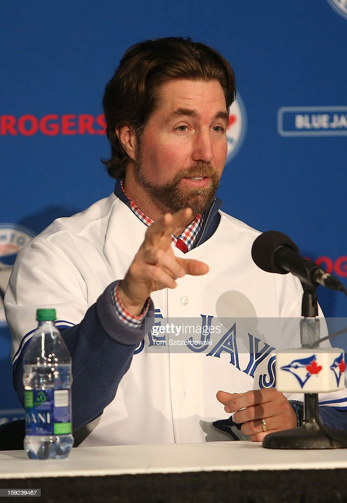 R.A. Dickey #43 of the Toronto Blue Jays tells reporters about the anxiety he felt when he threw a knuckleball to Vladimir Guerrero when he first adopted the new pitch during his introduction at a press conference at Rogers Centre on January 8, 2013 in Toronto, Ontario, Canada.