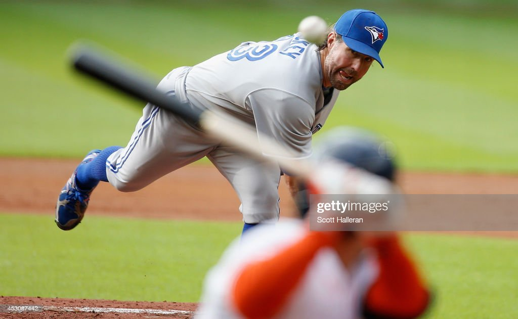 <a gi-track='captionPersonalityLinkClicked' href=/galleries/search?phrase=R.A.+Dickey&family=editorial&specificpeople=221719 ng-click='$event.stopPropagation()'>R.A. Dickey</a> #43 of the Toronto Blue Jays throws a pitch during the first inning to <a gi-track='captionPersonalityLinkClicked' href=/galleries/search?phrase=Jose+Altuve&family=editorial&specificpeople=7934195 ng-click='$event.stopPropagation()'>Jose Altuve</a> #27 of the Houston Astros at Minute Maid Park on August 2, 2014 in Houston, Texas.