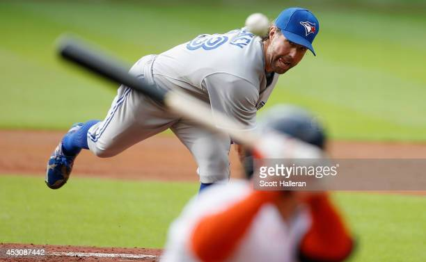 A Dickey of the Toronto Blue Jays throws a pitch during the first inning to Jose Altuve of the Houston Astros at Minute Maid Park on August 2 2014 in...