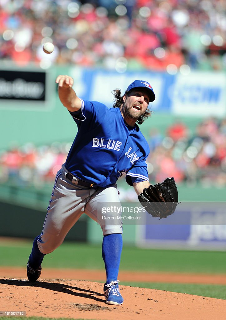 R.A. Dickey #43 of the Toronto Blue Jays throws a pitch in the first inning against the Boston red Sox at Fenway Park on September 22, 2013 in Boston, Massachusetts.