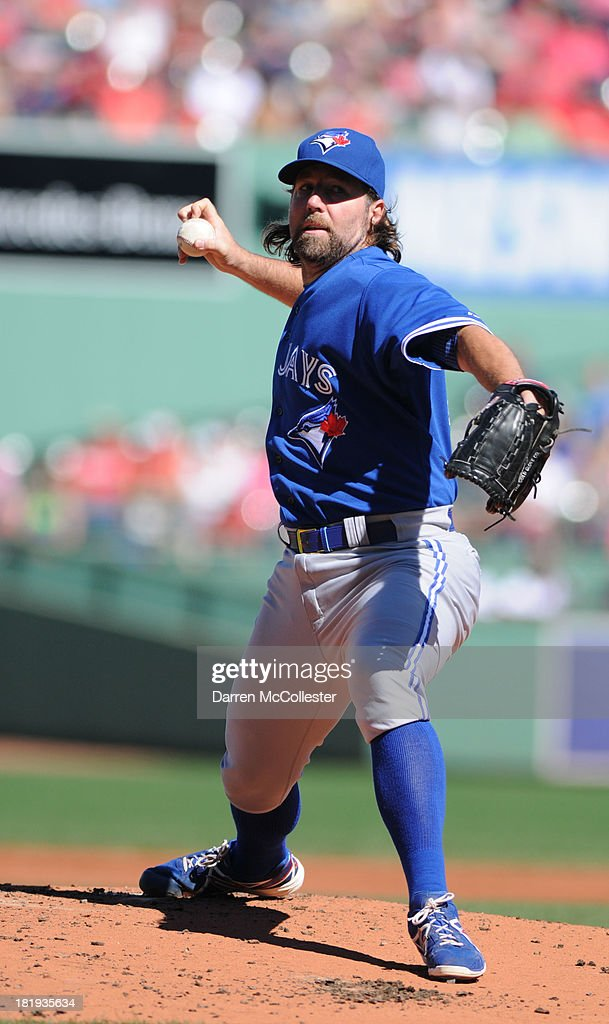 R.A. Dickey #43 of the Toronto Blue Jays throws a pitch in the first inning against the Boston Red Sox at Fenway Park on September 22, 2013 in Boston, Massachusetts. The Red Sox won the game 5-2.