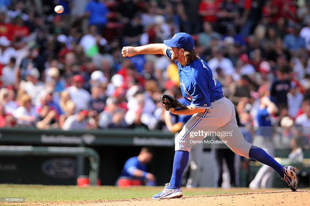 R.A. Dickey #15 of the Toronto Blue Jays throws a pitch in the fourth inning against the Boston Red Sox at Fenway Park on September 22, 2013 in Boston, Massachusetts. The Red Sox won the game 5-2.