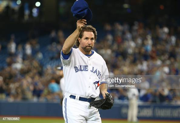 A Dickey of the Toronto Blue Jays tips his cap to the fans as he is relieved in the eighth inning during MLB game action against the New York Mets on...