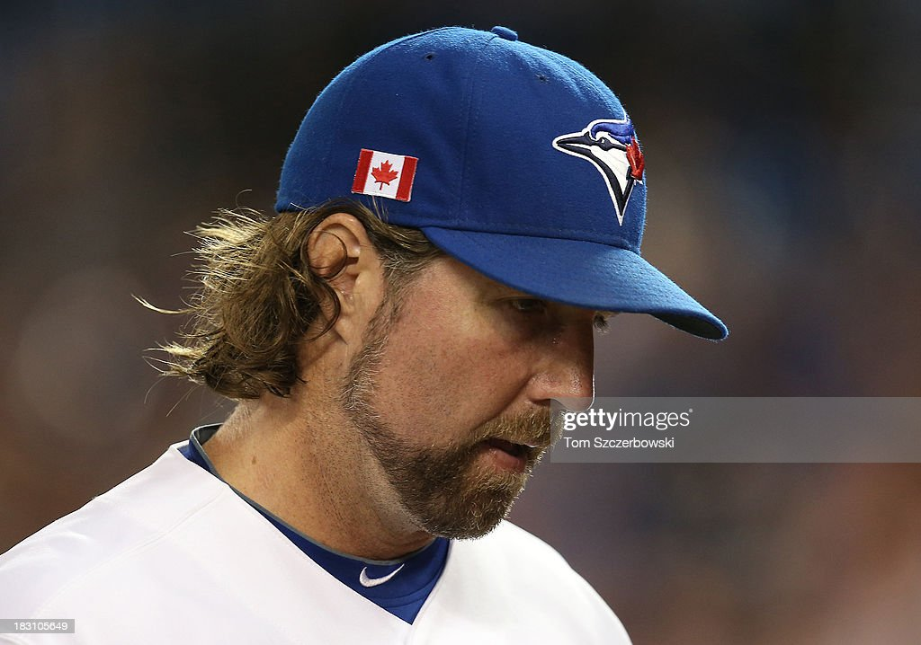R.A. Dickey #43 of the Toronto Blue Jays walks off the mound after retiring the side during MLB game action against the Los Angeles Angels of Anaheim on September 11, 2013 at Rogers Centre in Toronto, Ontario, Canada.