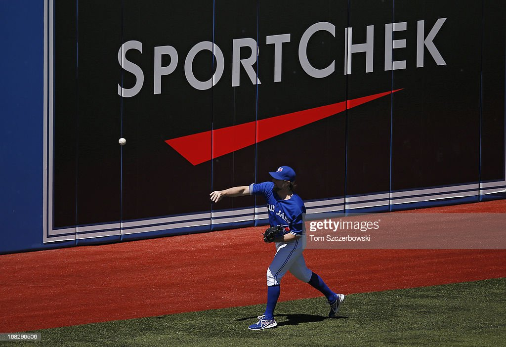 R.A. Dickey #43 of the Toronto Blue Jays warms up before an MLB game against the Seattle Mariners on May 4, 2013 at Rogers Centre in Toronto, Ontario, Canada.