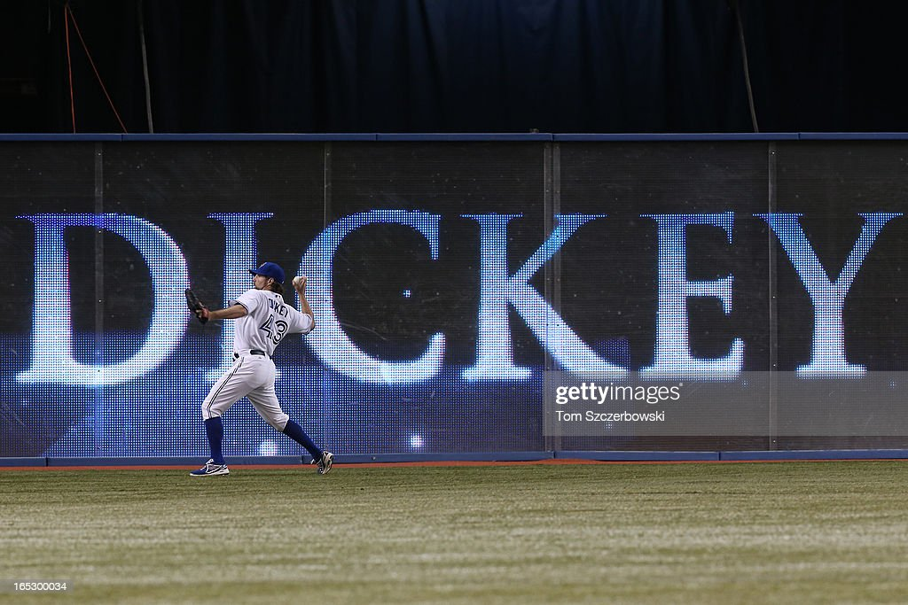 <a gi-track='captionPersonalityLinkClicked' href=/galleries/search?phrase=R.A.+Dickey&family=editorial&specificpeople=221719 ng-click='$event.stopPropagation()'>R.A. Dickey</a> #43 of the Toronto Blue Jays warms up in left field as he is recognized for his Cy Young Award from 2012 before MLB game action on Opening Day against the Cleveland Indians on April 2, 2013 at Rogers Centre in Toronto, Ontario, Canada.