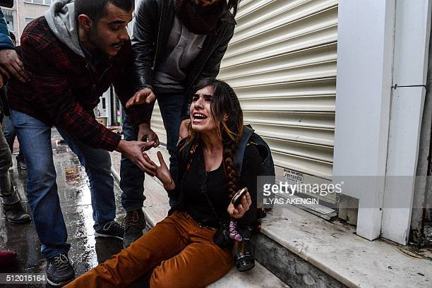 Dicle News Agency journalist Ayse Surme reacts after she was injured when Turkish police fired tear gas during a demonstration in Diyarbakir on...