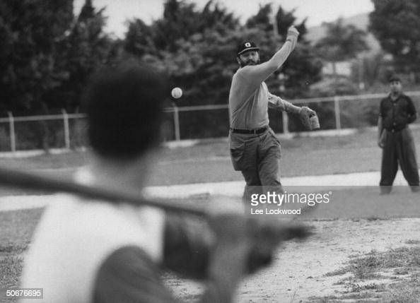 Dictator Fidel Castro pitching a baseball