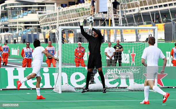 Dida of Brazil saves a shot from Sergio Perez of Mexico and Force India during the Heineken Champions of the Grid Charity football match during...