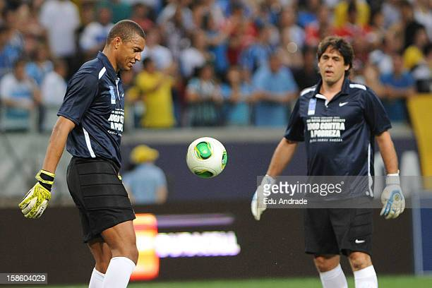 Dida plays with the ball before the 10th edition of Match Against Poverty between friends of Zidane and friends of Ronaldo at Arena Gremio Stadium on...