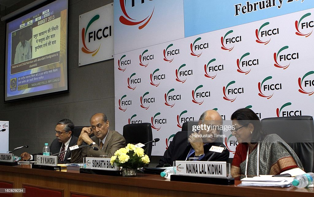 A Didar Singh, RV Kanoria, Sidharth Birla and Naina Lal Kidwai react during the direct telecast of the Union Budget 2013-14 during Industry - Media Interface on Union Budget Session 2013-14 at Federation House, FICCI on February 28, 2013 in New Delhi, India. India Inc gave a thumbs up to the UPA-II's last Union Budget before the general elections next year.