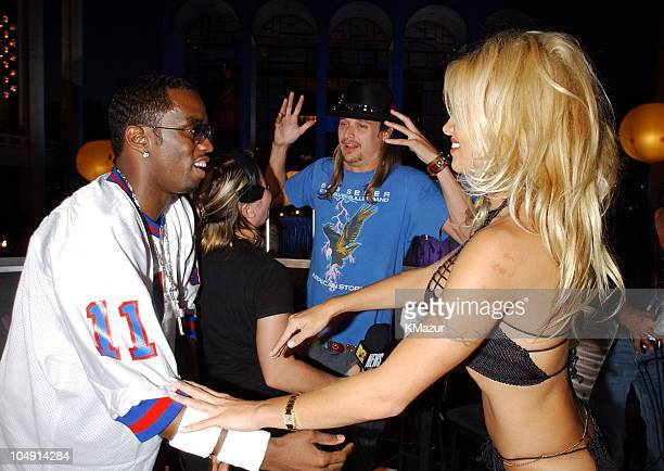 P Diddy and Pamela Anderson enjoy a moment with Kid Rock in the background