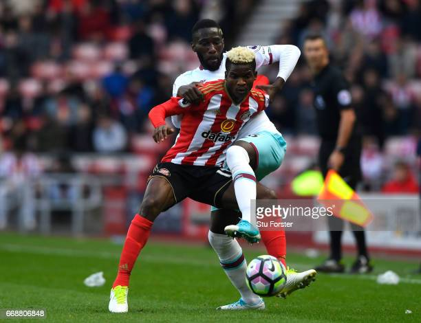 Dider N'dong of Sunderland and Arthur Masuaku of West Ham United battle for possession during the Premier League match between Sunderland and West...