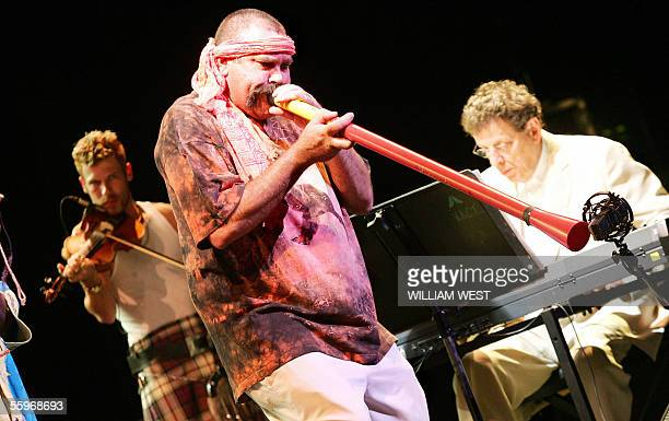Didgeridoo player Mark Atkin performs as reknown international musician Philip Glass plays the keyboards during rehearsal for a concert of world...