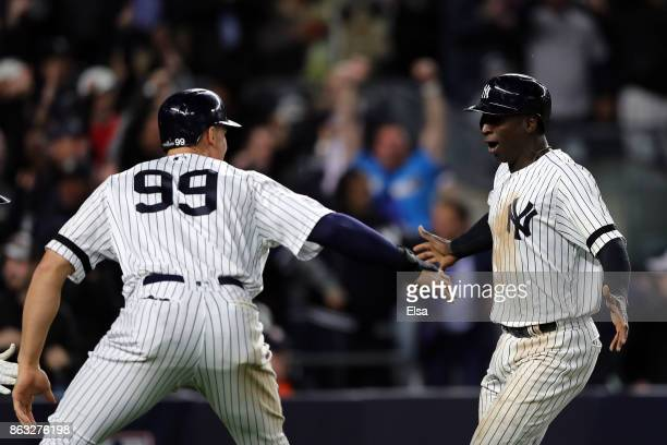 Didi Gregorius and Aaron Judge of the New York Yankees celebrate after scoring in the eighth inning against the Houston Astros during Game Four of...