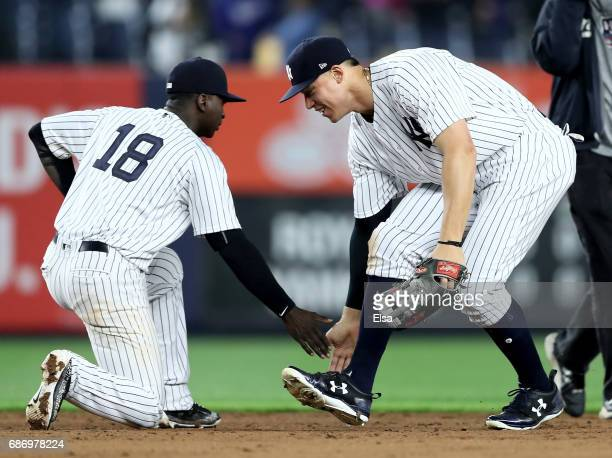 Didi Gregorius and Aaron Judge of the New York Yankees celebrate the 42 win over the Kansas City Royals on May 22 2017 at Yankee Stadium in the Bronx...
