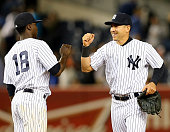 Didi Gregorius and Jacoby Ellsbury of the New York Yankees celebrate the win over the Baltimore Orioles on May 8 2015 at Yankee Stadium in the Bronx...