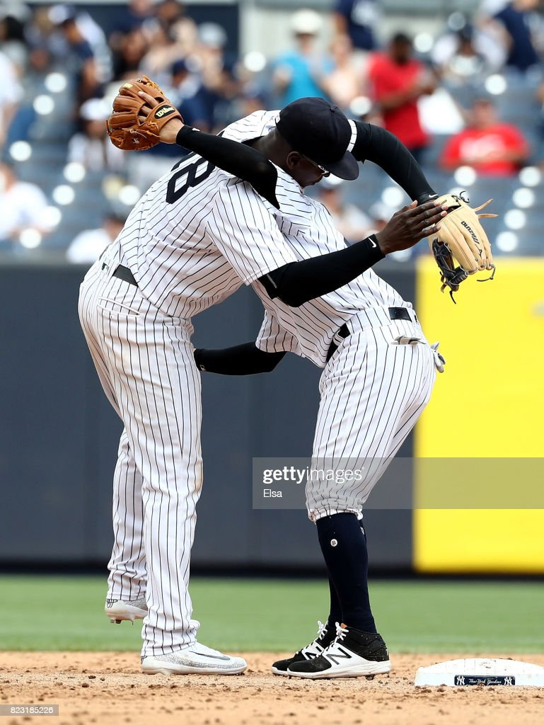 Didi Gregorius #18 and Ronald Torreyes #74 of the New York Yankees celebrate the 9-5 win over the Cincinnati Reds on July 26, 2017 at Yankee Stadium in the Bronx borough of New York City.