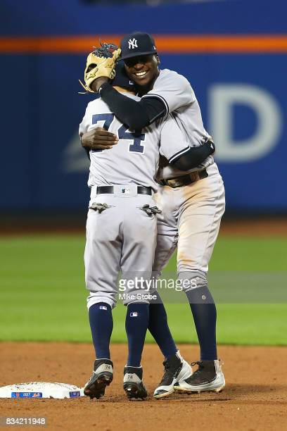 Didi Gregorius and Ronald Torreyes of the New York Yankees celebrate after defeating the New York Mets 75 at Citi Field on August 17 2017 in the...
