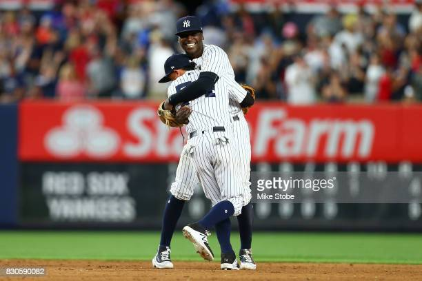 Didi Gregorius and Ronald Torreyes of the New York Yankees celebrates after defeating the Boston Red Sox 54 at Yankee Stadium on August 11 2017 in...