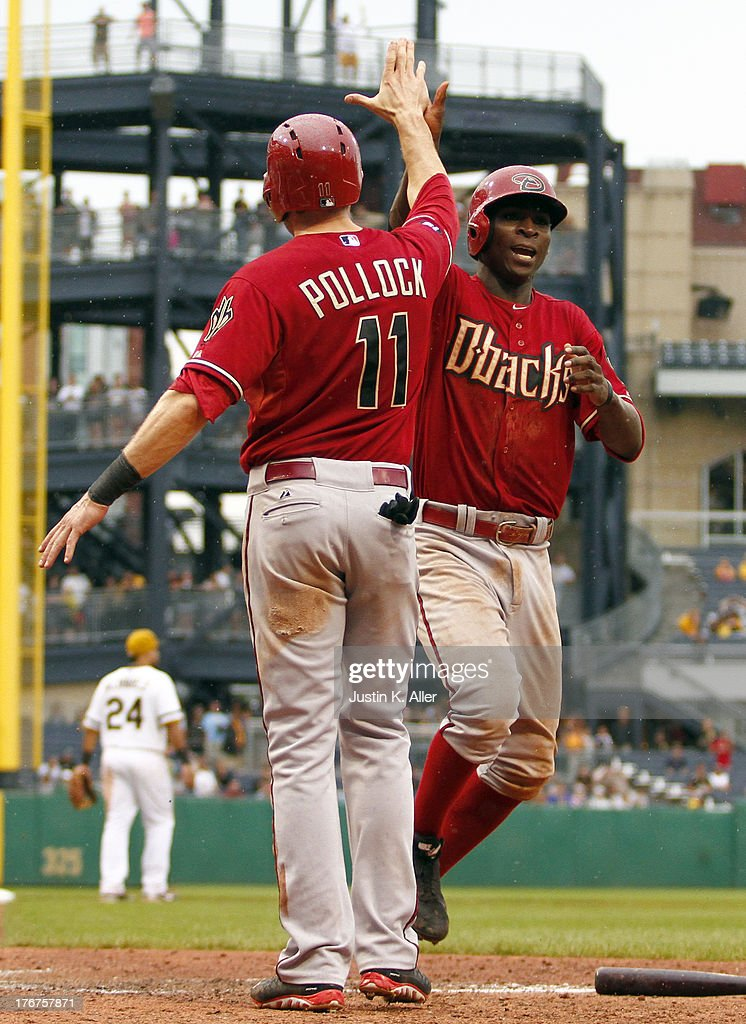 <a gi-track='captionPersonalityLinkClicked' href=/galleries/search?phrase=Didi+Gregorius&family=editorial&specificpeople=8945889 ng-click='$event.stopPropagation()'>Didi Gregorius</a> #1 of the Arizona Diamondbacks celebrates with A.J. Pollock #11 after scoring on a two RBI double in the sixteenth inning against the Pittsburgh Pirates during the game on August 18, 2013 at PNC Park in Pittsburgh, Pennsylvania.
