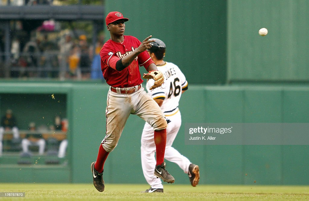 <a gi-track='captionPersonalityLinkClicked' href=/galleries/search?phrase=Didi+Gregorius&family=editorial&specificpeople=8945889 ng-click='$event.stopPropagation()'>Didi Gregorius</a> #1 of the Arizona Diamondbacks fields a ground ball against the Pittsburgh Pirates in the sixteenth inning during the game on August 18, 2013 at PNC Park in Pittsburgh, Pennsylvania.