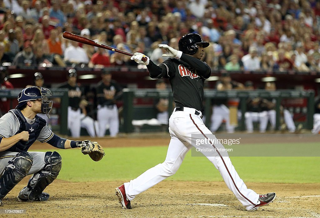 <a gi-track='captionPersonalityLinkClicked' href=/galleries/search?phrase=Didi+Gregorius&family=editorial&specificpeople=8945889 ng-click='$event.stopPropagation()'>Didi Gregorius</a> #1 of the Arizona Diamondbacks hits a RBI single against the Milwaukee Brewers during the seventh inning of the MLB game at Chase Field on July 13, 2013 in Phoenix, Arizona.