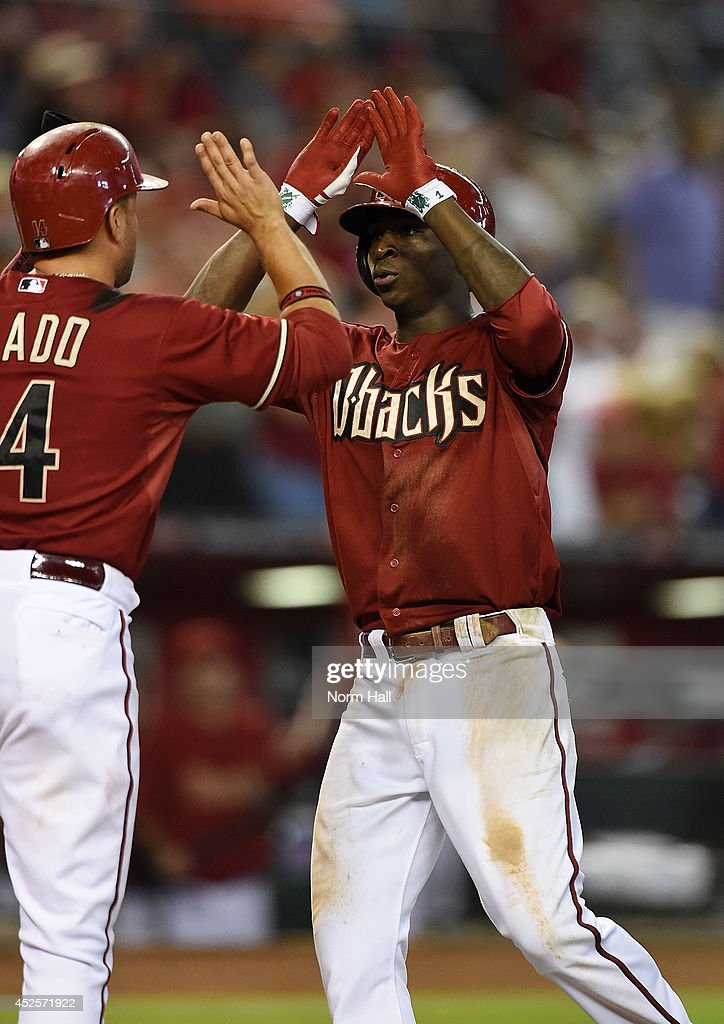 <a gi-track='captionPersonalityLinkClicked' href=/galleries/search?phrase=Didi+Gregorius&family=editorial&specificpeople=8945889 ng-click='$event.stopPropagation()'>Didi Gregorius</a> #1 of the Arizona Diamondbacks is congratulated by teammate <a gi-track='captionPersonalityLinkClicked' href=/galleries/search?phrase=Martin+Prado&family=editorial&specificpeople=620159 ng-click='$event.stopPropagation()'>Martin Prado</a> #14 after hitting a home run against the Detroit Tigers during the fifth inning at Chase Field on July 23, 2014 in Phoenix, Arizona.
