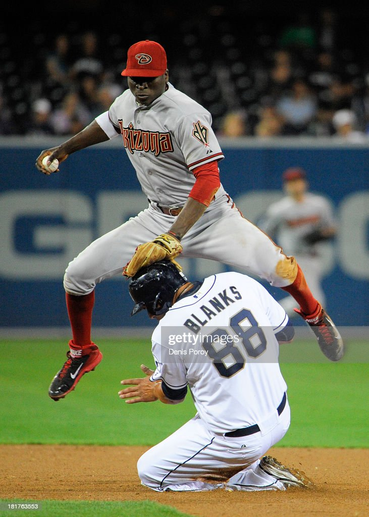 <a gi-track='captionPersonalityLinkClicked' href=/galleries/search?phrase=Didi+Gregorius&family=editorial&specificpeople=8945889 ng-click='$event.stopPropagation()'>Didi Gregorius</a> #1 of the Arizona Diamondbacks jumps over <a gi-track='captionPersonalityLinkClicked' href=/galleries/search?phrase=Kyle+Blanks&family=editorial&specificpeople=4901863 ng-click='$event.stopPropagation()'>Kyle Blanks</a> #88 of the San Diego Padres after getting the force out during the fifth inning of a baseball game at Petco Park on September 24, 2013 in San Diego, California. Gregorius was unable to turn the double play.