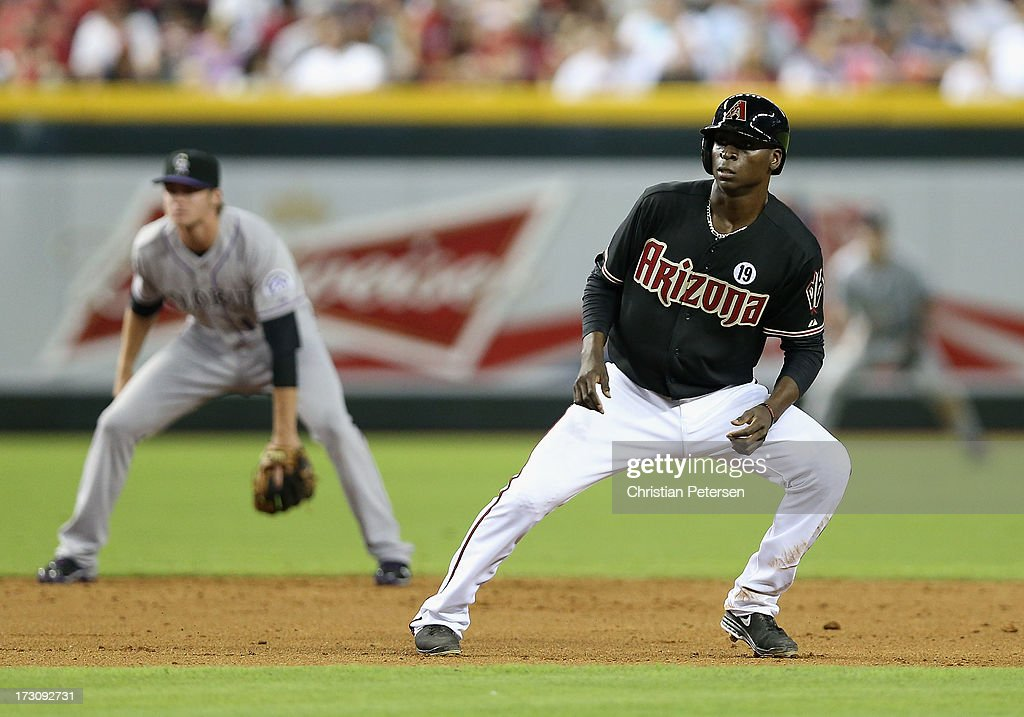 <a gi-track='captionPersonalityLinkClicked' href=/galleries/search?phrase=Didi+Gregorius&family=editorial&specificpeople=8945889 ng-click='$event.stopPropagation()'>Didi Gregorius</a> #1 of the Arizona Diamondbacks leads off second base during the MLB game against the Colorado Rockies at Chase Field on July 5, 2013 in Phoenix, Arizona. The Diamondbacks defeated the Rockies 5-0.